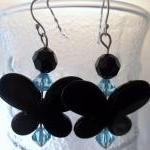 Black Butterfly with teal bead acce..